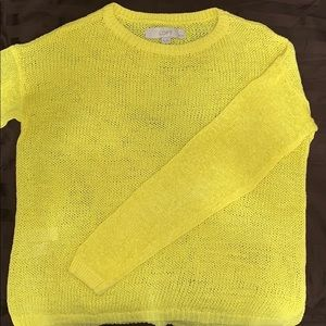 Bright yellow knit sweater